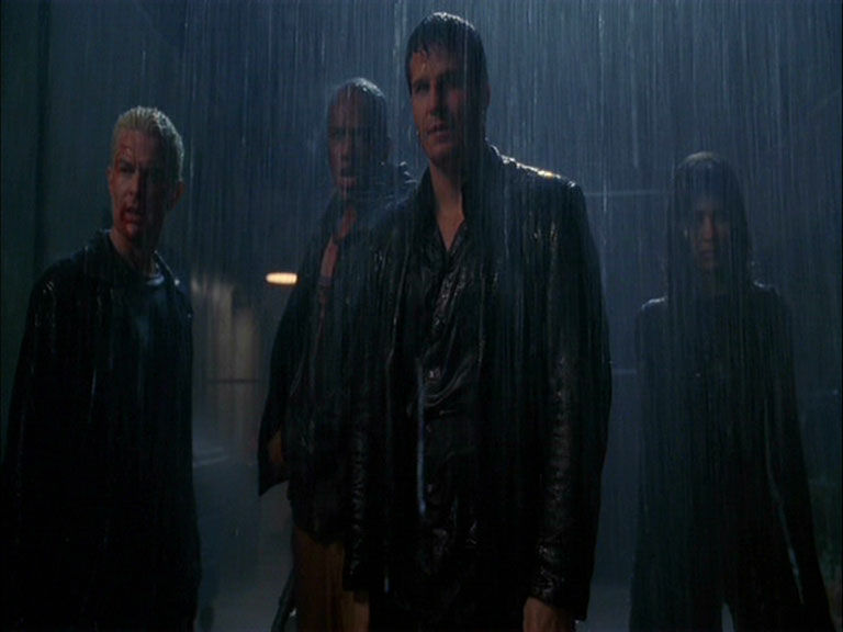 Last shot from the Angel series finale. Gunn, Angel, Illyria, and Lorne standing in the rain.